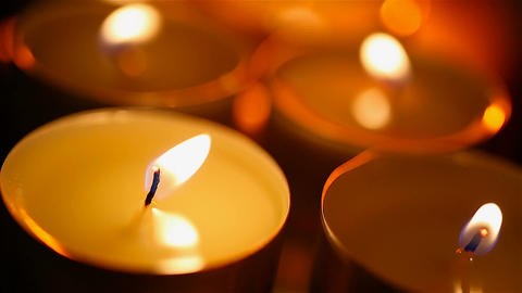 Round candles burning in bedroom, romantic and intimate atmosphere, close-up Footage