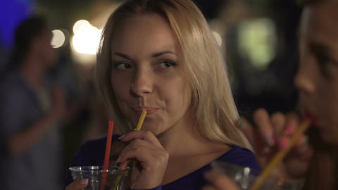 Hot blonde drinking cocktail, looking at sexy girl passionately, nightclub flirt Live Action