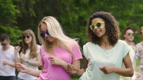 Female friends moving to music at party, happiness and relaxation, smiling girls Footage
