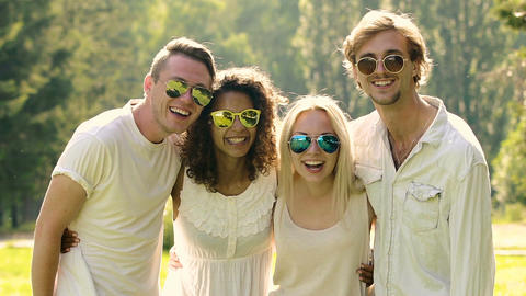 Healthy smiles on faces of happy young people in clean white clothes, friendship Footage