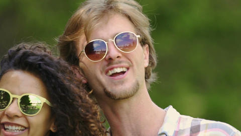 Multicultural couple in sunglasses dancing and smiling, healthy lifestyle, joy Footage
