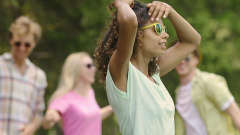 Mixed race girl in yellow sunglasses dancing at talent show casting, youth Footage