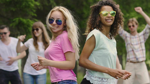 Happy cheerful young people dancing like crazy at music festival, emotions, fun Footage