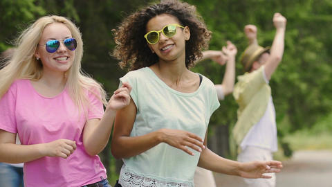 Young attractive people dancing outdoors, celebrating life, party atmosphere Footage