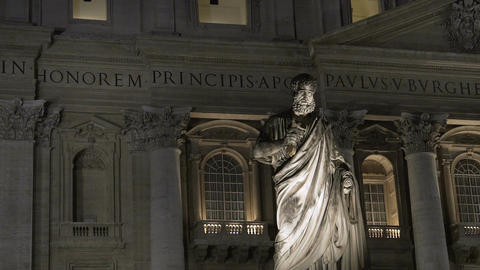 Facade of Italian Renaissance church and St. Peter monument at night, landmark Footage