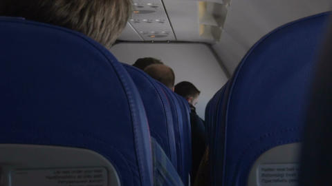 Passengers sitting in airplane cabin and talking, transportation, tourism Footage