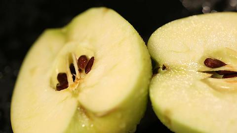 Halves of fresh apple prepared for cooking healthy dessert, sweet juicy fruit Footage
