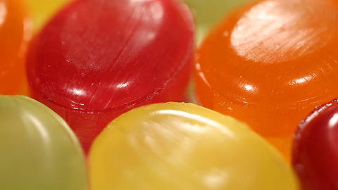 Close-up of multicolored sweet hard candies, childhood dream, happy vivid life Live Action