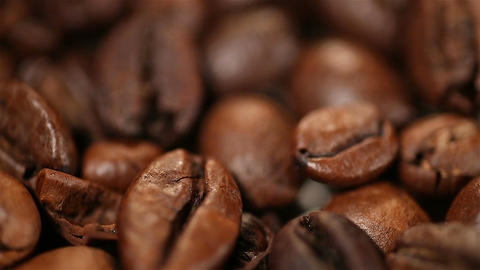 Roasted coffee beans rotating on stand, aromatic invigorating drink production Footage