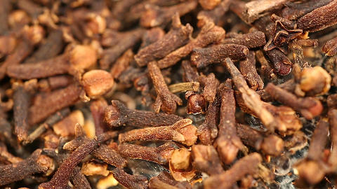 Pile of flavorful dried cloves, aromatic additive to dishes and hot beverages Footage