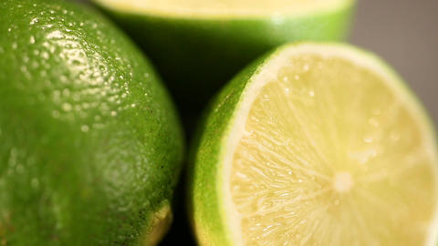 Green lime cut before squeezing refreshing energetic juice, healthy lifestyle Footage