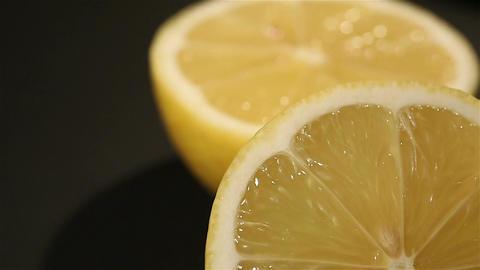 Juicy lemon cut in half close-up, preparation of lemonade, cooking school Live Action