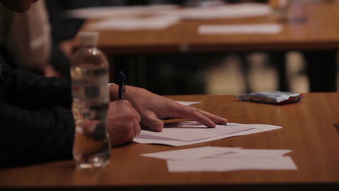 Jury sitting at table, making notes during beauty contest, competition Footage