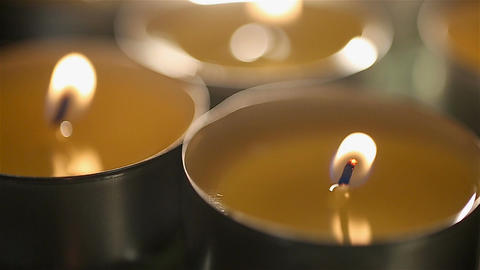 Relaxing atmosphere and burning candles at massage room in spa salon, closeup Footage