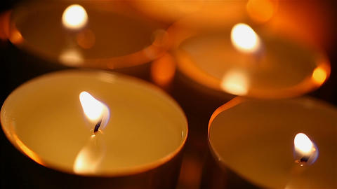 Mystical atmosphere and fading candles, close-up of candlelight in dark room Footage