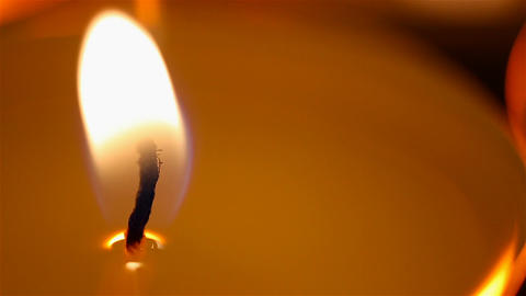 Beautiful burning candle close-up, fire goes out, romantic atmosphere on date Footage