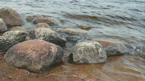 smooth boulders polished by waves Live Action