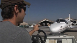 Cessna Citation Tug Tow out of hanger Stock Video Footage