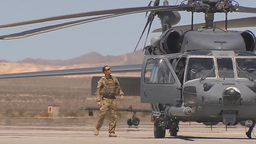 HH-60 Pavehawk air crew member performs pre-flight checks before takeoff Footage