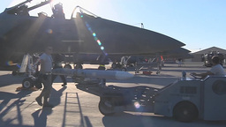 A missile is unloaded from an F-15E Eagle Footage