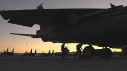 Ground crew members collect their things from around an F-15E during Red Flag Footage