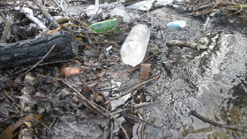 Brook littered with household wastes Footage