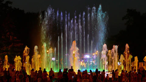 Beautiful fountain with changing colorful lighting Footage