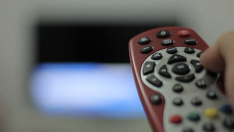 Close up shot of a male hand holding the TV remote control Footage