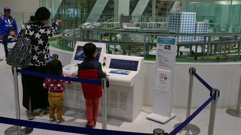 Family Playing With Scale Model At Kyoto Railway Museum Japan Footage