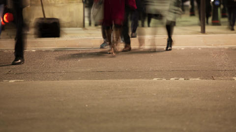 Low section of commuters legs crossing a road Footage