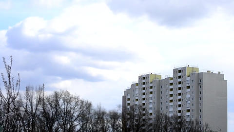 Clouds move above apartment block Footage