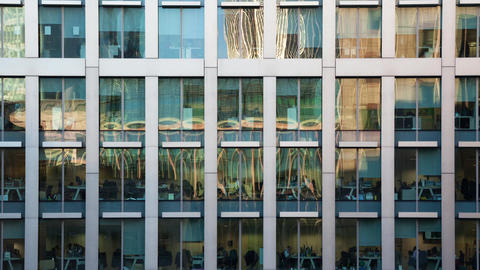 Time lapse of the exterior of a modern office block Footage