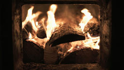 burning wood in a fireplace Image