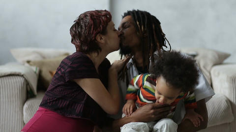 Beautiful mixed couple in loving embrace at home Footage