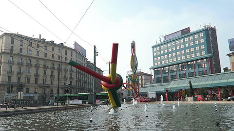 Milan, Italy Cadorna train station square Needle sculpture Footage