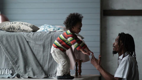 Playful hipster dad playing with his son at home Footage