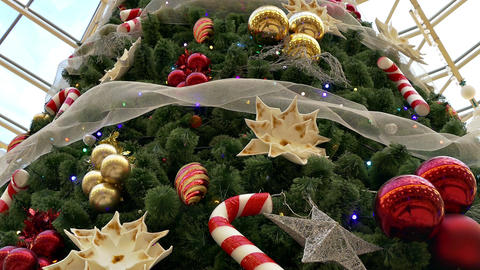 1080p Big Decorated Christmas Tree in Shopping Center Flickers With Festive Footage