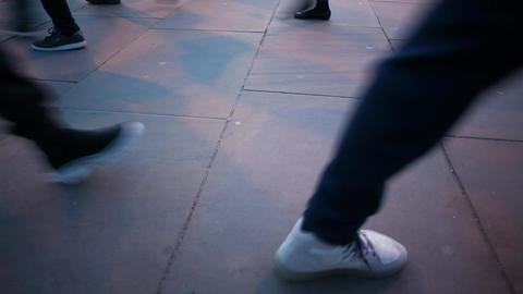 Time-lapse of commuters legs at dusk Footage