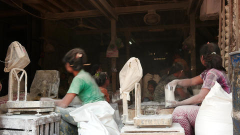 Flour packing factory in Mandalay of Myanmar with pretty young working women Footage