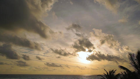Sunrise sky with passing clouds over an ocean horizon Footage