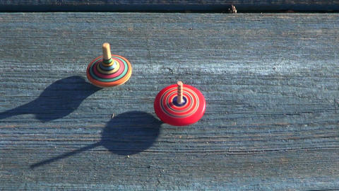 Two multicolored wooden spins whirligigs Footage