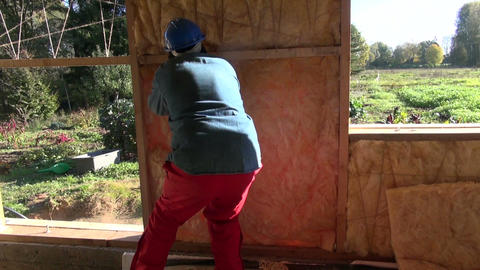 Builder insulating house with mineral wool Live Action