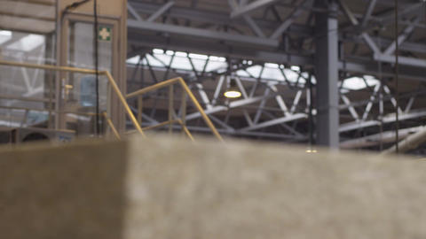 Worker Controls Soundproofing and Insulation Production Footage