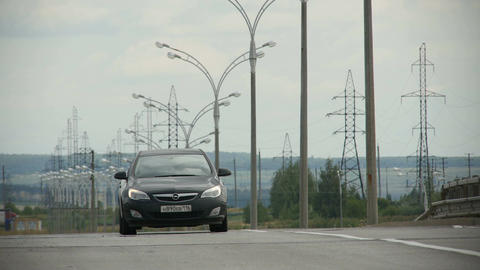 Black Modern Auto Drives along Empty Highway with Street Lights Footage