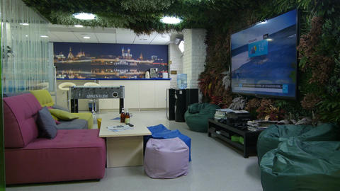 Waiting Hall with Large TV Screen on Wall and Cosy Sofa Footage