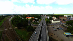 Camera follows cars, on the bridge. Aerial footage Archivo