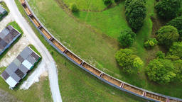 Arial footage of train on the railroad. Empty train from the top Bild