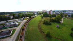 Arial footage of train on the railroad. Empty train from the top Image