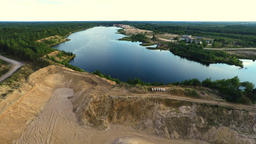 Flight over sand quarry and lake. Nature landscape. Aerial footage Filmmaterial