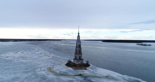 Aerial view Bell tower between water and ice Filmmaterial